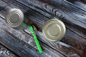 two aluminum cans on wooden background