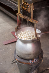 Boiling silkworm cocoon in pot
