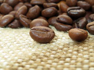 Coffee beans on burlap closeup