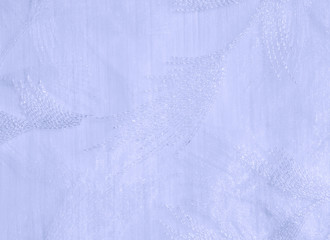 Texture, background, pattern. Tulle of pastel tones. Close the purple folded lace. Pastel purple crumpled tulle as background. Macro view of sewing dresses. Pure wedding textiles.