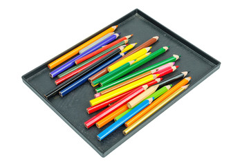 Color drawing pencils in black box on a white background, isolated