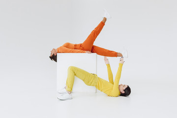 two women on white cube