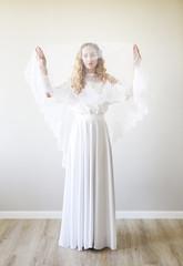 Young pretty blond woman wearing wedding dress