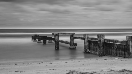 The old Mentone Beach Jetty in black and white