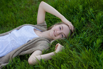 teen girl  lays on the grass