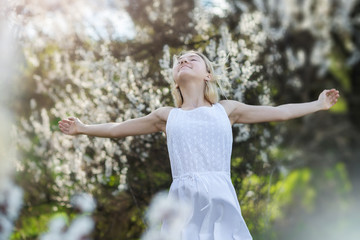 Beautiful young teen girl outdoors enjoy nature in springtime