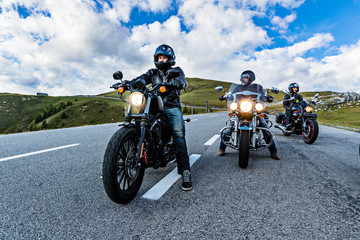 Motorcycle drivers riding in Alpine highway, Nockalmstrasse, Austria, Europe. Wall mural