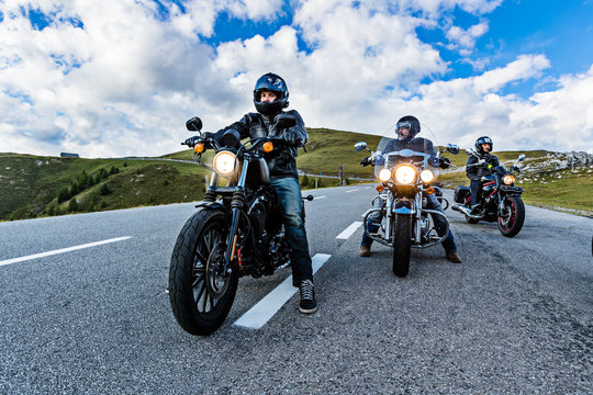 Motorcycle drivers riding in Alpine highway, Nockalmstrasse, Austria, Europe.