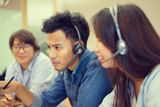 close up asian man working as call center,network engineering resolving problem concept,