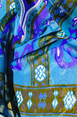 Background texture Blue silk fabric with a pattern. this light silk braided can be turned into your design. With the help of several segments from this print, you can get precious samples of your work