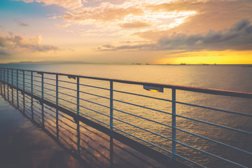 Cruise ship railing at sunset after a rainy day.