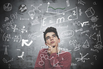 thoughtful child or adolescent with formulas, learn