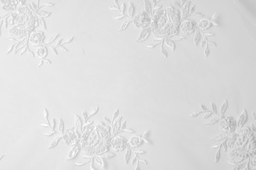 texture Tulle is white Growing in a bold floral design do not miss the chance to purchase this white on white floral embroidered tulle Large floral vignettes grow  columns over a clean soft tulle