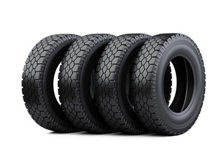 Set of four big vehicle truck tires stacked. New car wheels.