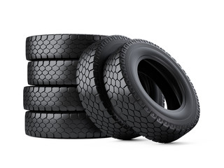 Set of six big vehicle truck tires stacked. New car wheels.