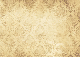 Old yellowed paper background with vintage ornament.