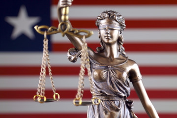 Symbol of law and justice with Liberia Flag. Close up.