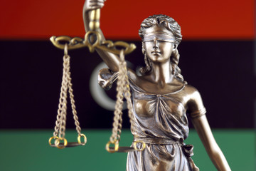 Symbol of law and justice with Libya Flag. Close up.