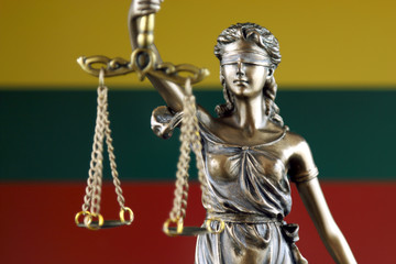 Symbol of law and justice with Lithuania Flag. Close up.