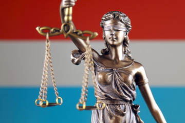 Symbol of law and justice with Luxembourg Flag. Close up.