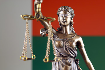 Symbol of law and justice with Madagascar Flag. Close up.