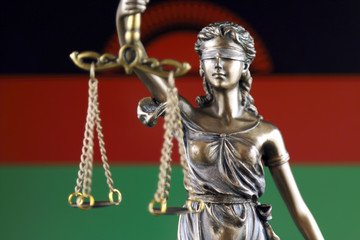 Symbol of law and justice with Malawi Flag. Close up.
