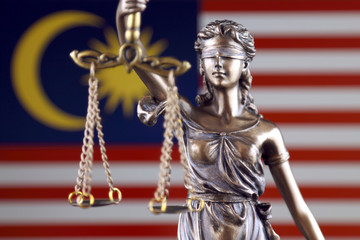Symbol of law and justice with Malaysia Flag. Close up.