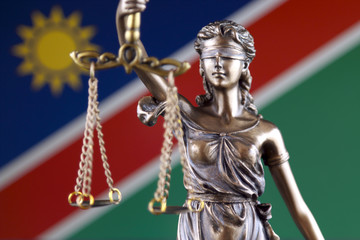 Symbol of law and justice with Namibia Flag. Close up.