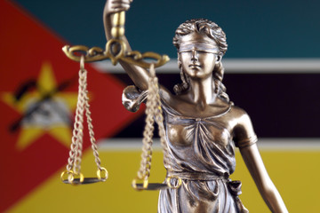 Symbol of law and justice with Mozambique Flag. Close up.