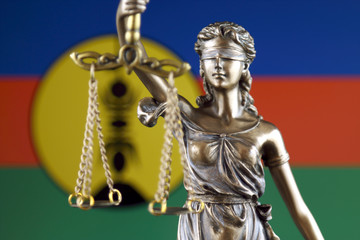 Symbol of law and justice with New Caledonia Flag. Close up.