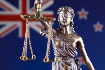 Symbol of law and justice with New Zealand Flag. Close up.
