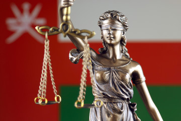 Symbol of law and justice with Oman Flag. Close up.