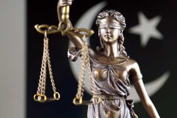 Symbol of law and justice with Pakistan Flag. Close up.