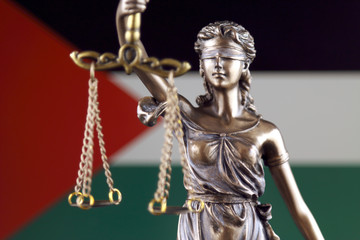 Symbol of law and justice with Palestine Flag. Close up.