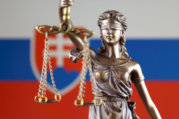 Symbol of law and justice with Slovakia Flag. Close up.