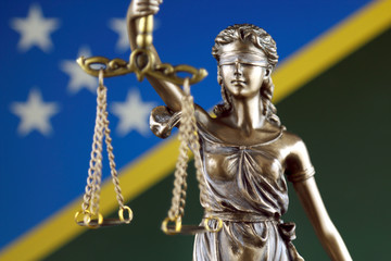 Symbol of law and justice with Solomon Islands Flag. Close up.