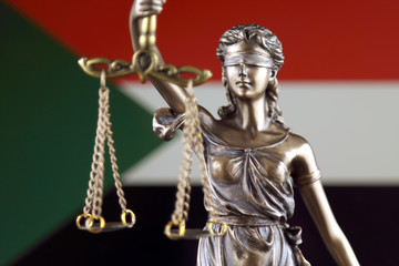 Symbol of law and justice with Sudan Flag. Close up.