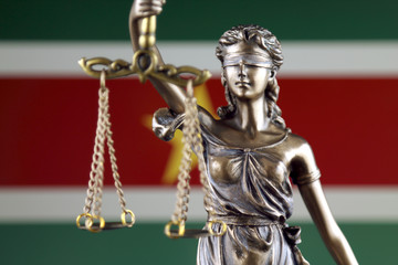 Symbol of law and justice with Suriname Flag. Close up.