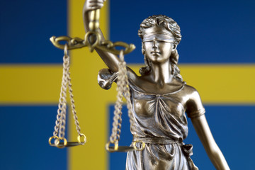 Symbol of law and justice with Sweden Flag. Close up.