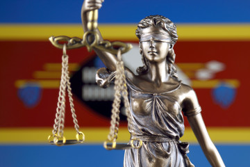 Symbol of law and justice with Swaziland Flag. Close up.