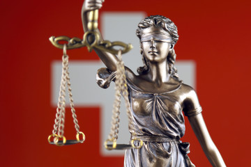 Symbol of law and justice with Switzerland Flag. Close up.
