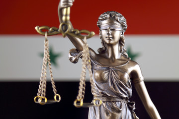 Symbol of law and justice with Syria Flag. Close up.