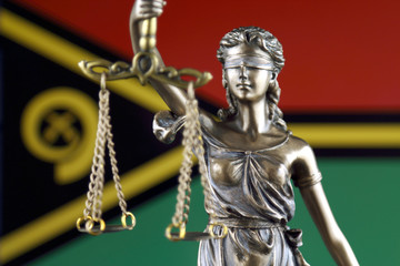 Symbol of law and justice with Vanuatu Flag. Close up.