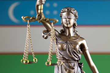 Symbol of law and justice with Uzbekistan Flag. Close up.