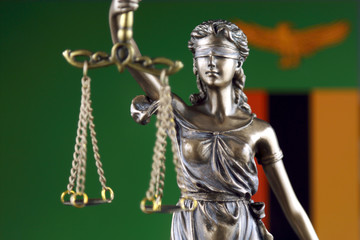Symbol of law and justice with Zambia Flag. Close up.