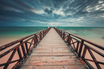 Wooden jetty reaching into the turquoise Caribbean sea