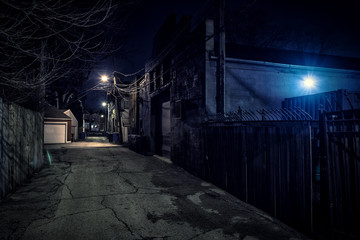 Wall Mural - Dark empty scary urban city street alley with vintage buildings at night
