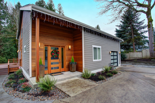 Charming newly renovated home exterior with mixed siding