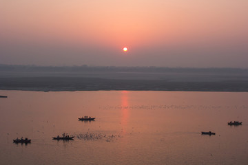 The sunrise over the Ganges river in Varanasi.