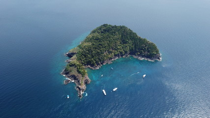 Aerial photo tropical island and dive boats in Thailand
